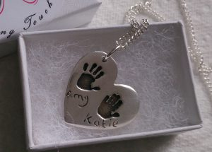 Double handprint necklace