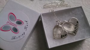 Double fingerprint necklace with 2 heart jewellery charms