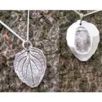 Silver leaf pendant with hidden fingerprint